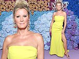 Sandra Lee, 55, shows a lot of leg in a sexy slit dress