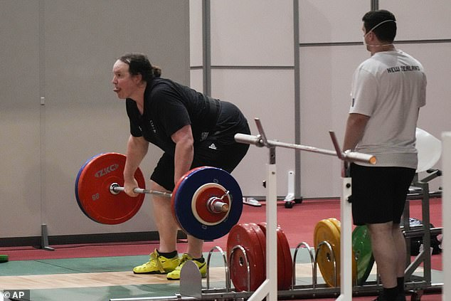 Hubbard of New Zealand practices on Saturday in Tokyo as her coach watches on