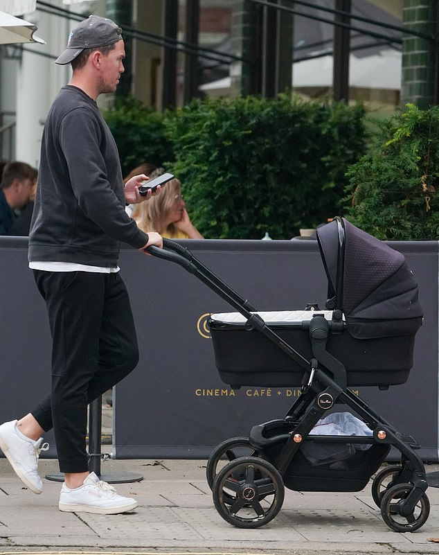 Checking: Max was on his phone as he pushed the pram