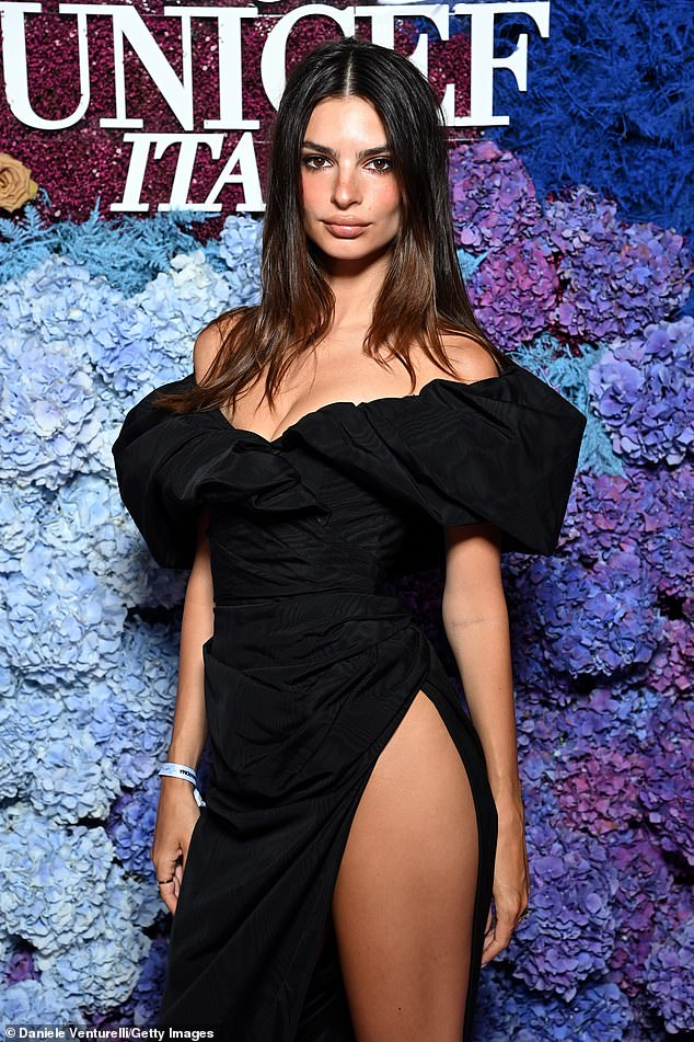 Hot stuff:The model and actress, 30, looked jaw-dropping as she posed up a storm, with her tanned and toned leg peeking out from beyond the split which extended to her hip