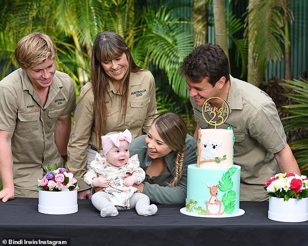 Mum life:The newly turned 23-year-old was joined by her husband Chandler, brother Robert and mum Terri Irwin in a second picture