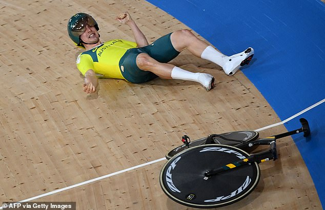 Australia's Alexander Porter reacts after crashing during the men's track cycling team pursuit qualifying event during the Tokyo 2020 Olympic Games
