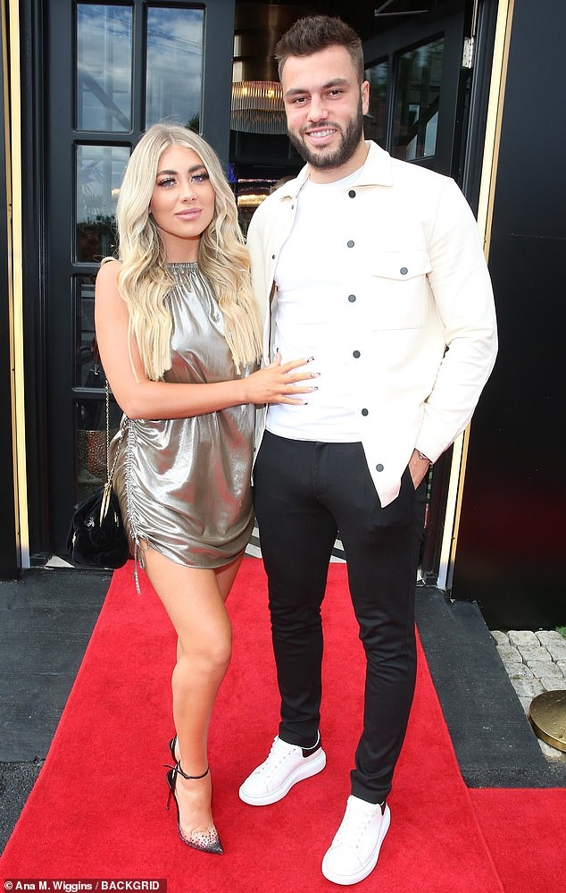 So smitten:Paige Turley and Finley Tapp put on a loved-up display as they attended the launch of Kem Cetinay's restaurant Array in Romford, Essex on Saturday night