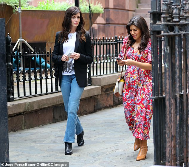 Castmate: WeCrashed also stars Emmy winner America Ferrera (R, pictured July 9) as WeWork staff member Elishia Kennedy