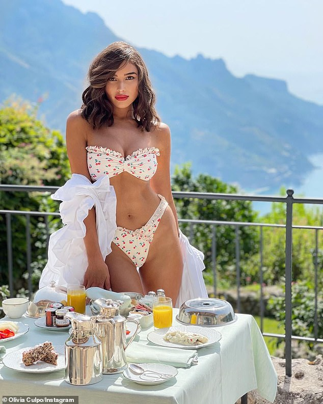 Sweet look: She previously posted photos in a cherry-patterned Lovers and Friends bikini in front of a table with a white tablecloth and a breakfast spread
