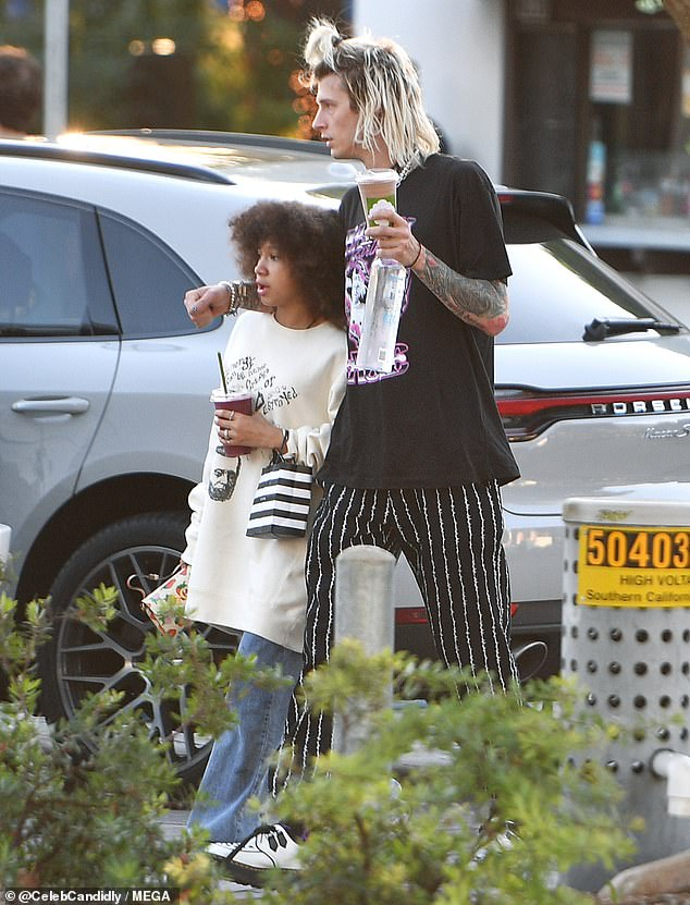 Oi: Her look had several punk touches like pinstripe pants with barbed wire stripes and white Creeper style shoes