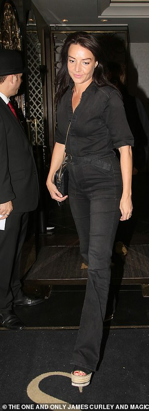 Trim: Debbie kept her things safe in a chain handbag and accentuated her fitted waist with a belt