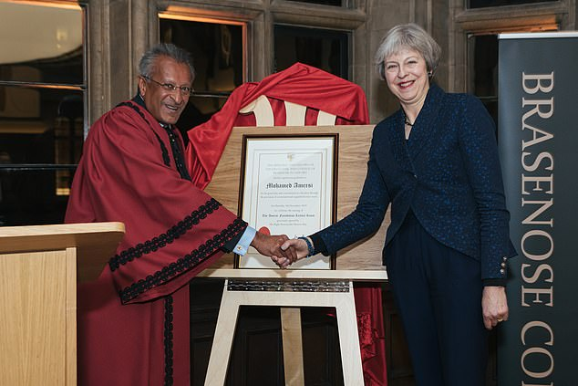Mohamed Amersi (left) said the Conservatives would have treated him better if he had a traditional English name and had been to Eton and Oxford. (Pictured right, former Prime Minister Theresa May)