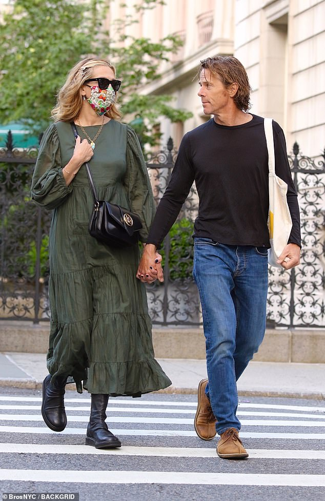 The look of love!Julia Roberts and her husband Danny Moder proved they were going from strength to strength as they enjoyed a romantic, hand-held stroll through New York City on Monday