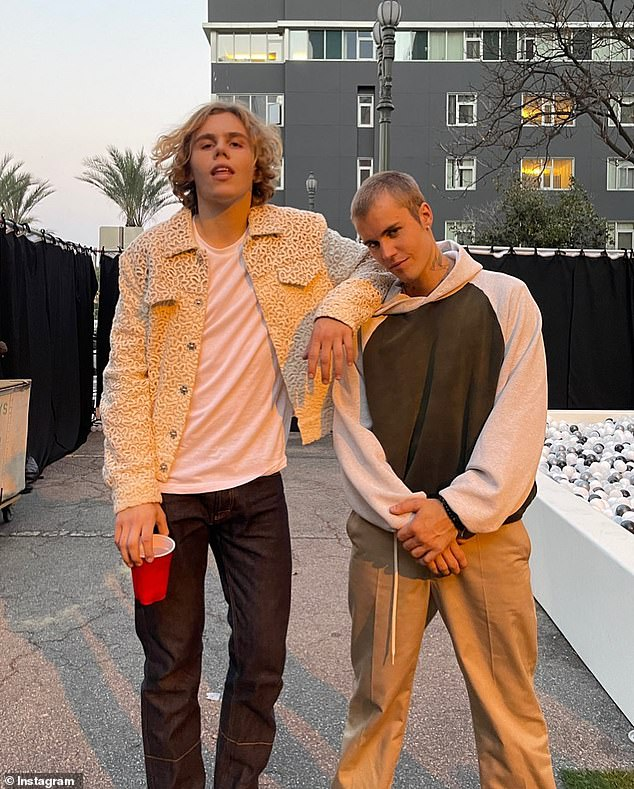 Spitting image: One fan even compared Jackson to The Kid Laroi (left), which prompted him to respond: 'Kid Laroi-looking geek.' Pictured: the Australian rapper posing with Justin Bieber
