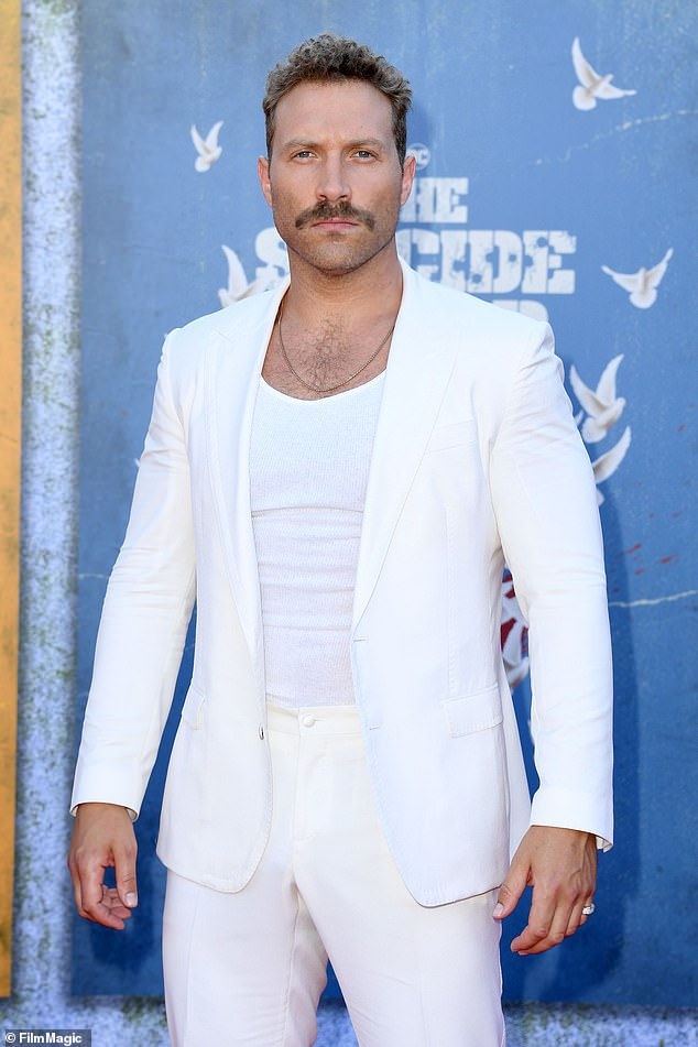 Handsome: The actor, 35, opted for a rugged look with an impressive mustache and light beard.  Her look was completed with subtle hints of bling with a chain around her neck and a ring on her pinky finger.
