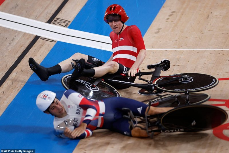 Denmark's Frederik Madsen (top) bizarrely ploughed into Team GB's Charlie Tanfield (bottom) during the men's cycling pursuit