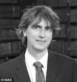The notion comes from Imperial College London quantum physicist Terry Rudolph (pictured), who theorizes 'paranoid' aliens are harnessing the power of entangled photons from various stars to send these hidden messages