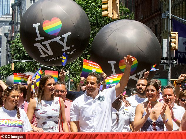 Cuomo (pictured with his daughters at Pride in 2019) divorced Kerry Kennedy ¿ Bobby Kennedy's seventh child ¿ in 2005