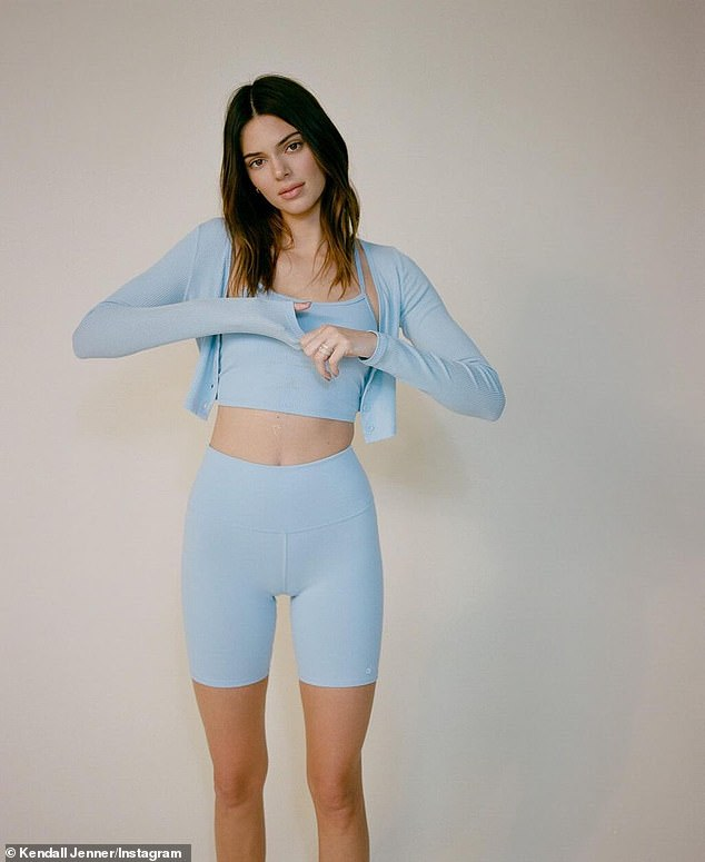 Namaste: Kendall Jenner turned out not to miss a day on the mat by showing off her sculpted abs wearing a powder blue Alo Yoga set on Instagram