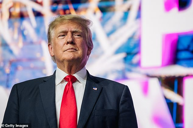 President Donald Trump is blamed by many vaccinated people for the current surge in COVID cases. Trump is vaccinated, and encouraged his supporters to get jabbed. Pictured: Former President Trump makes an entrance at the Rally To Protect Our Elections conference in Phoenix, Arizona, July 2021