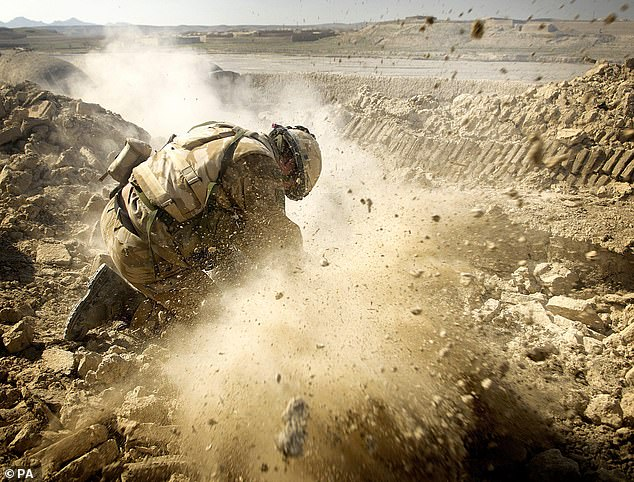 Twenty years after the War on Terror began, it's time that we took a long, unsparing look at what it really achieved. Pictured: A Royal Marine Commando firing a mortar in 2007