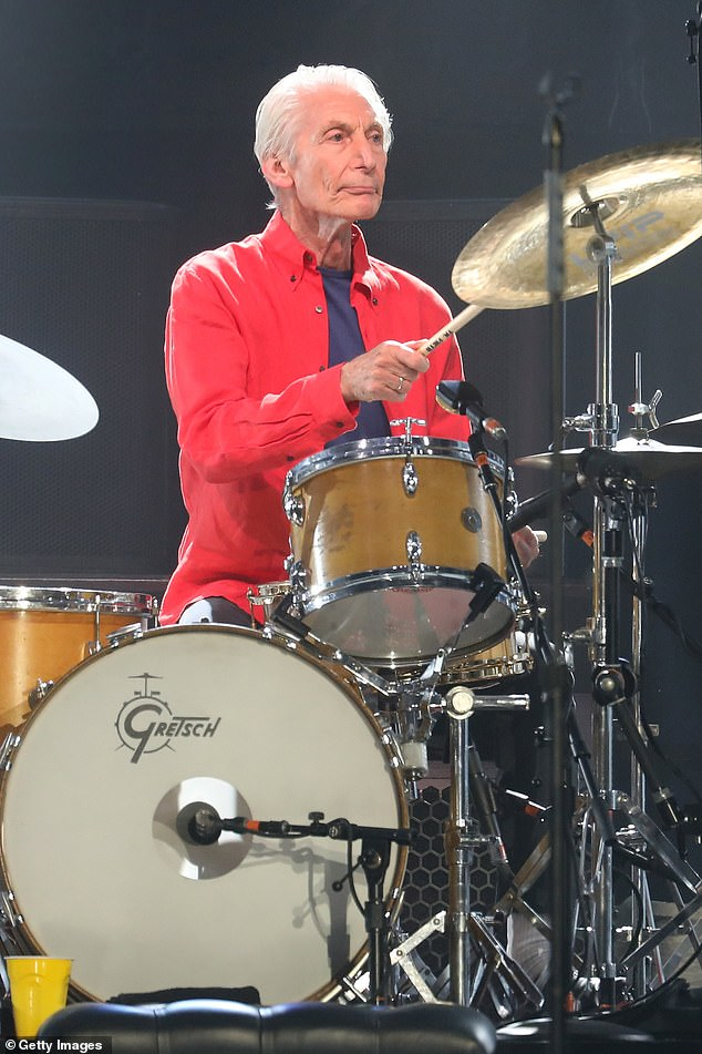On hold:The rock legend insisted he's been told 'the show must go on' after drummer Charlie withdrew from the group's upcoming performances following an emergency operation