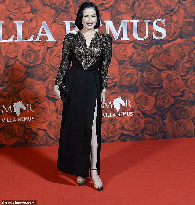 Stylish: Dita, 48, real name Heather Renée Sweet, wore an elegant black slit dress that included stunning details on the arms and bodice