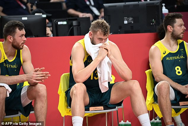 Australia's Jock Landale (centre) reacts next to teammate Matthew Dellavedova (right) after their loss to the USA