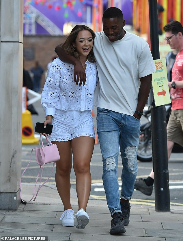 Cosy: Love Island's Aaron Francis and Sharon Gaffka appeared to seek solace in each other on Wednesday as they put on a very cosy display while leaving The Prince restaurant in London's Chelsea