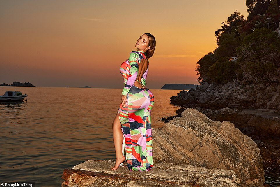 Style: Demi looked gorgeous in a backless patterned maxi dress she modeled at sunset