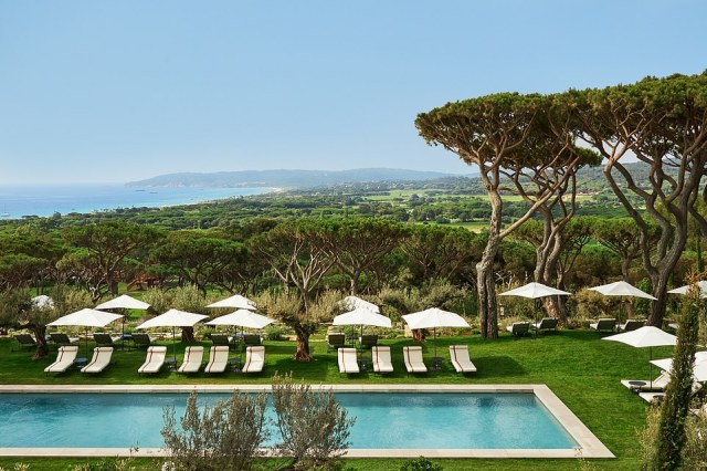 The spellbinding view over umbrella pine trees to Pampelonne Bay and the glistening superyachts anchored within