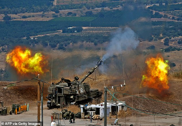 Israeli artillery launches bombardments on southern Lebanon after around a dozen rockets were fired by Hezbollah