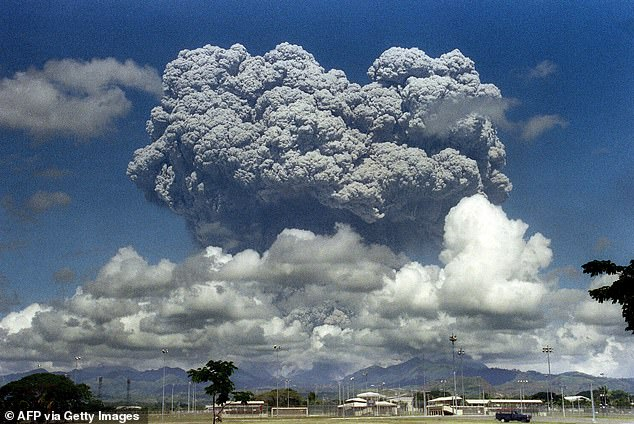 A giant volcanic mushroom cloud explodes some 20 kilometers high from Mount Pinatubo above almost deserted US Clark Air Base, on June 12, 1991