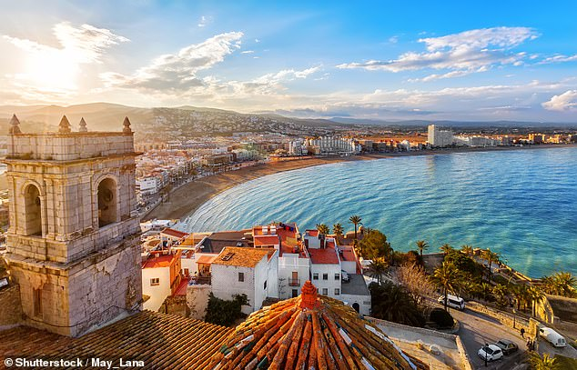 Spain has long been a favourite for UK holidaymakers, and its status on the amber list hasn't deterred tourists. Pictured is the popular port city of Valencia