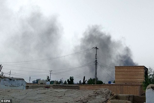 In other parts of the country, Taliban fighters intensified clashes with Afghan forces and attacked militias allied with the government. Above,smoke rising as Taliban attacked parts of the city in Lashkar Gah, on August 6