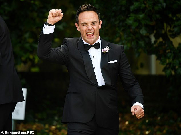 Thrilled: Ant beamed as he punched the air in delight while leaving the service which was attended by a host of celebrities