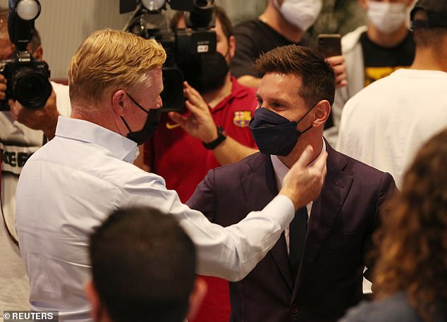 Barcelona manager Ronald Koeman (left) greets Messi after watching him say his farewells