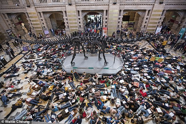 Members of the public stage a 'die-in' protest at the Kelvingrove Art Gallery and Museum in Glasgow, Scotland