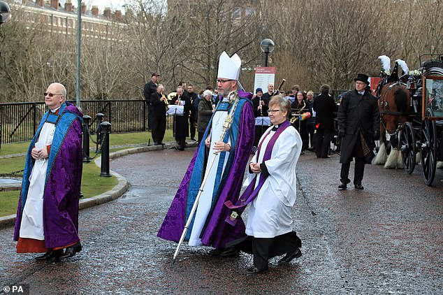 The Bishop of Liverpool, Paul Bayes (centre), led 20 vicars in reading the complete Book of Revelation — on the same platform as various XR doomsday cultists had been performing a ritual they called a 'die-in'