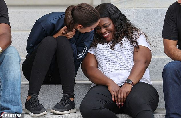 Democratic Reps. Alexandria Ocasio-Cortez and Cori Bush celebrate after news of the new CDC order on Tuesday after leading a camp out on the Capitol steps for four days