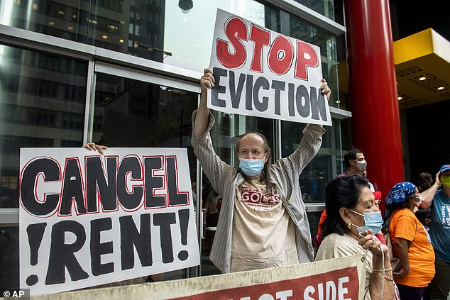 Housing advocates protest outside Governor Andrew Cuomo's office on the eviction moratorium on Wednesday, Aug. 4, 2021, in New York
