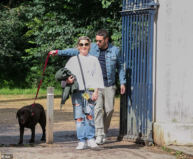 Puppy love:The pair were seen at a west London park on Sunday with her pet pooch Hurley - whom Lisa shares custody with ex Ant
