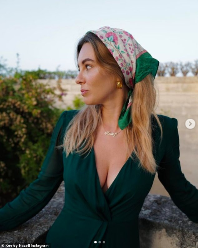 Style: Days later she was posing during sunset in the same green dress she wore in the loved-up snaps posted on David's Instagram account on Sunday