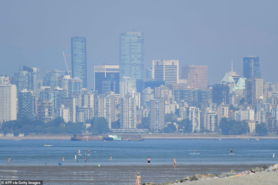 More than 230 deaths were reported in British Columbia after a blistering heatwave, labelled a once-in-10,000-year 'heat dome', gripped Canada and the US West Coast. The Canadian city of Vancouver is pictured