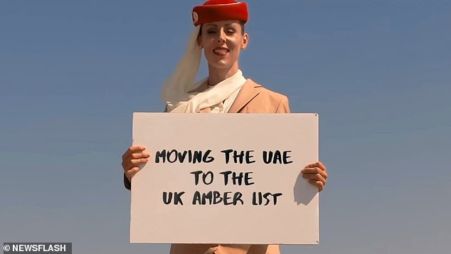 She held up variously placards to celebrate the UK moving the UAE to its Amber list