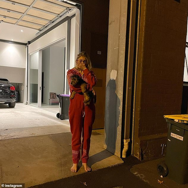 Missing her man: In a post on Instagram at the time of his move, Andy shared a photo of a distraught Bec, 29, sobbing outside of their Melbourne home as he said goodbye to her and their puppy, Henri