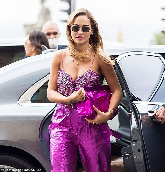 Glam: Rita added a slick of pink lipstick and wore her blonde locks down with a gentle curl