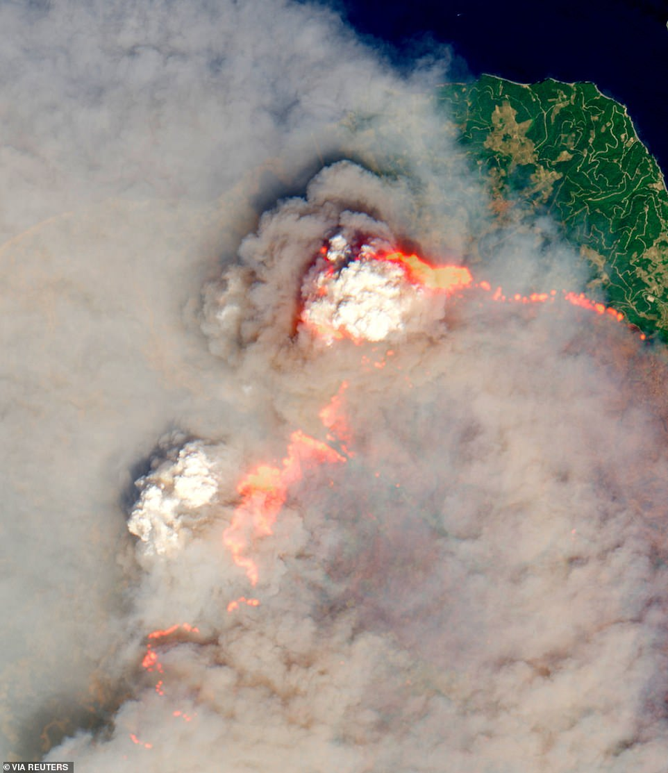 Fires rage across woodland on the north of the island of Evia, Greece, in an image captured by EU weather satellites on Sunday but released on Monday