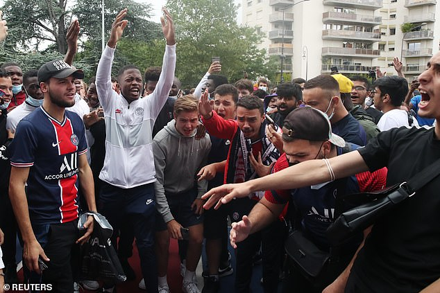 Excited Paris Saint-Germain fans gathered outside the Parc des Princes on Monday as they await the arrival of Argentine superstar Lionel Messi
