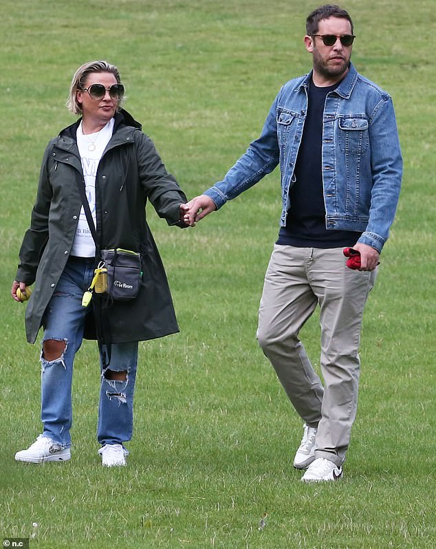 Message to the world: Lisa Armstrong wore a £125 smiley face Ganni sweatshirt during outing with beau James Green on Sunday in West London