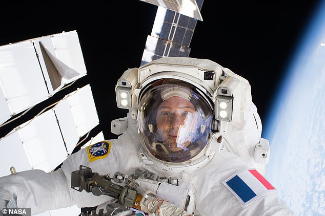 Footage of the fun was uploaded to Twitter by the French flight engineer Thomas Pesquet (pictured), one of the seven crew making up the present ' Expedition 65 ' on the ISS