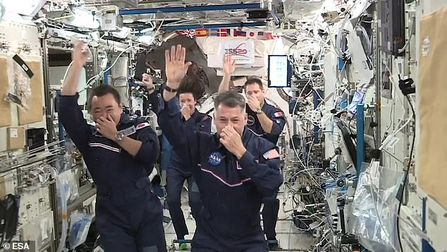 Astronauts on board the International Space Station have released hilarious clips from the unofficial 'Space Olympics' they held in the weightlessness of Earth's orbit. Pictured: asynchronised space swimming routine is performed on the orbiting laboratory