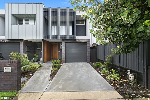 Modern:The two-level duplex has four bedrooms, including a master suite with an ensuite, and a study nook