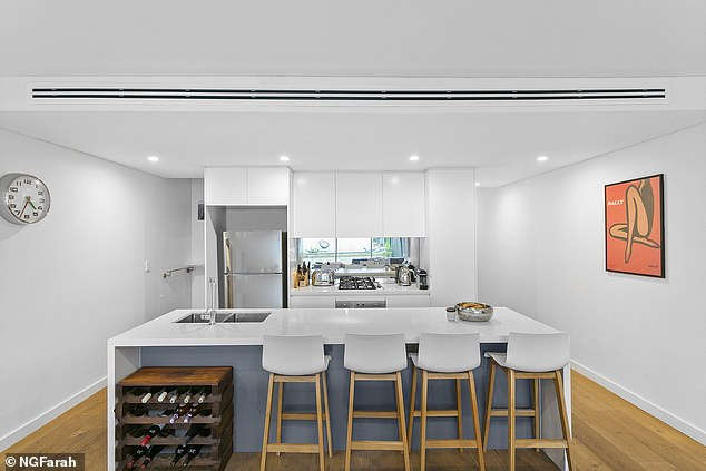 Spacious:There is a modern kitchen with a large island bench and high-end appliances, including a Miele dishwasher